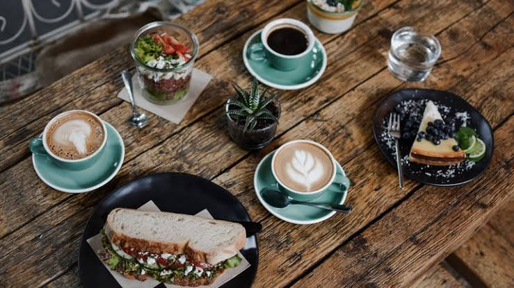 coffee and sandwiches on table